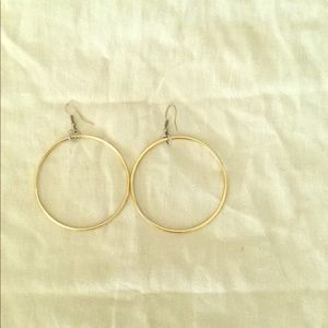 Gold hoop earrings, perfect quality. Never worn